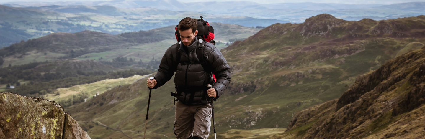 http://Young%20Male%20Hiker%20Moving%20Up%20Mountain,%20The%20Lake%20District,%20Cumbria,%20Uk