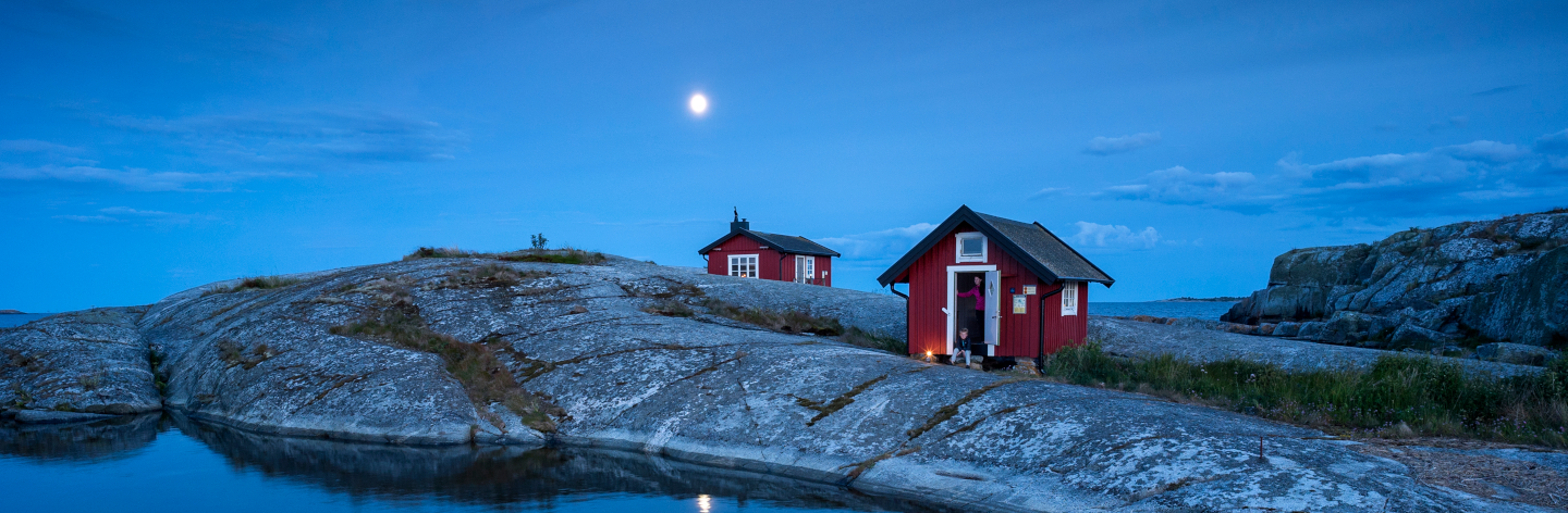 Wooden House On Rocky Coast