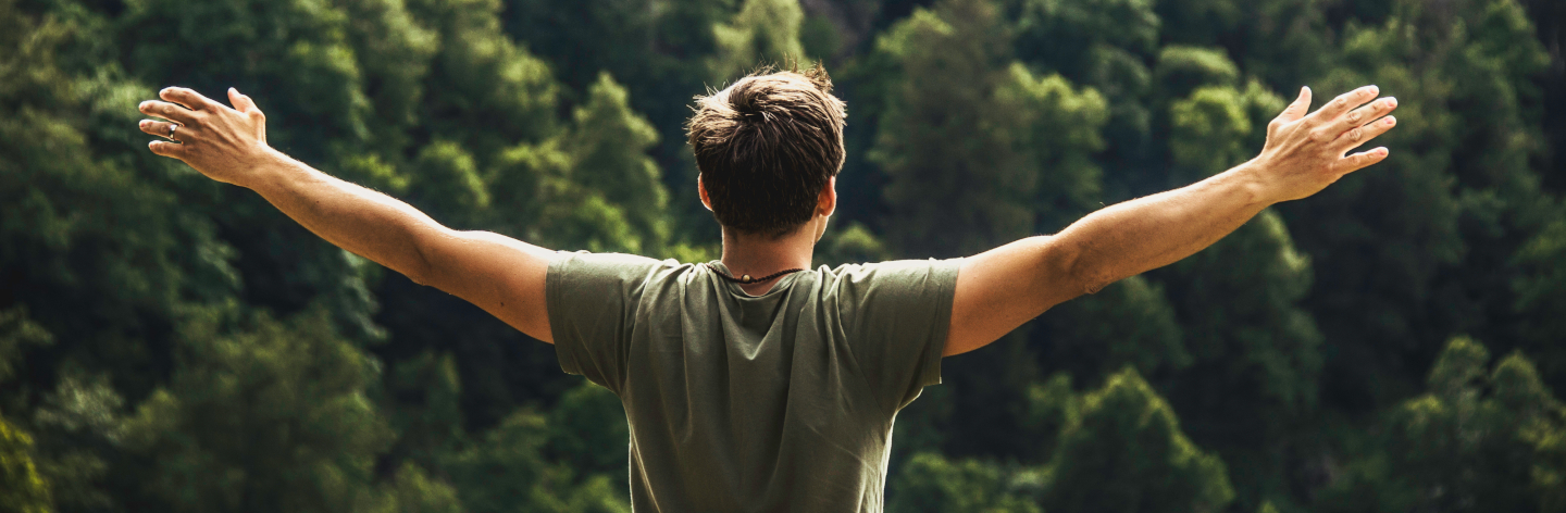 A Young Man Enjoying Freedom After Hiking At The Bodetal Valley In Thale Harz Mountains, Thale, Saxony Anhalt, Germany